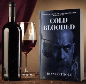 bottle of wine with wine glass and book entitled Cold Blooded