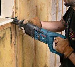 Reciprocating saw cutting through dry-wall